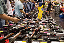 """Houston Gun Show at the George R. Brown Convention Center"" by http://flickr.com/photos/glasgows/ - http://flickr.com/photos/glasgows/432945997/. Licensed under CC BY 2.0 via Commons - https://commons.wikimedia.org/wiki/File:Houston_Gun_Show_at_the_George_R._Brown_Convention_Center.jpg#/media/File:Houston_Gun_Show_at_the_George_R._Brown_Convention_Center.jpg"