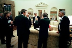 On Wednesday evening, March 19, 2003, President George W. Bush meets with his national security and communications advisors after authorizing military operations. Present, from left, are Steve Hadley, Deputy National Security Advisor; Karen Hughes, special advisor to the President; Chairman of the Joint Chiefs of Staff Richard B. Myers; Dan Bartlett, Communications Director; Vice President Dick Cheney, Secretary of Defense Donald Rumsfeld; National Security Advisor Condoleezza Rice; and Secretary of State Colin Powell. WHITE HOUSE PHOTO BY ERIC DRAPER