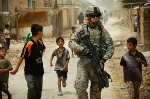 Iraqi children gather around as U.S. Army Pfc. Shane Bordonado patrols the streets of Al Asiriyah, Iraq, on Aug. 4, 2008. Bordonado is assigned to 2nd Squadron, 14th Cavalry Regiment, 25th Infantry Division. DoD photo by Spc. Daniel Herrera, U.S. Army. (Released)